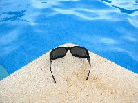 Polarized Sun Glasses and Precision Tinted Lenses (POTs) Can Help Reduce Glare
